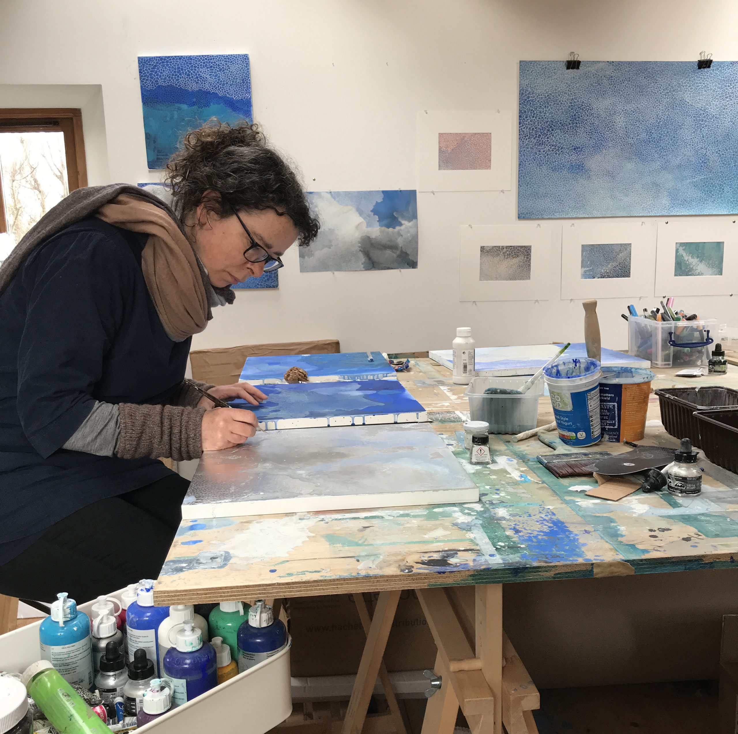 A picture of the artist at work in her studio