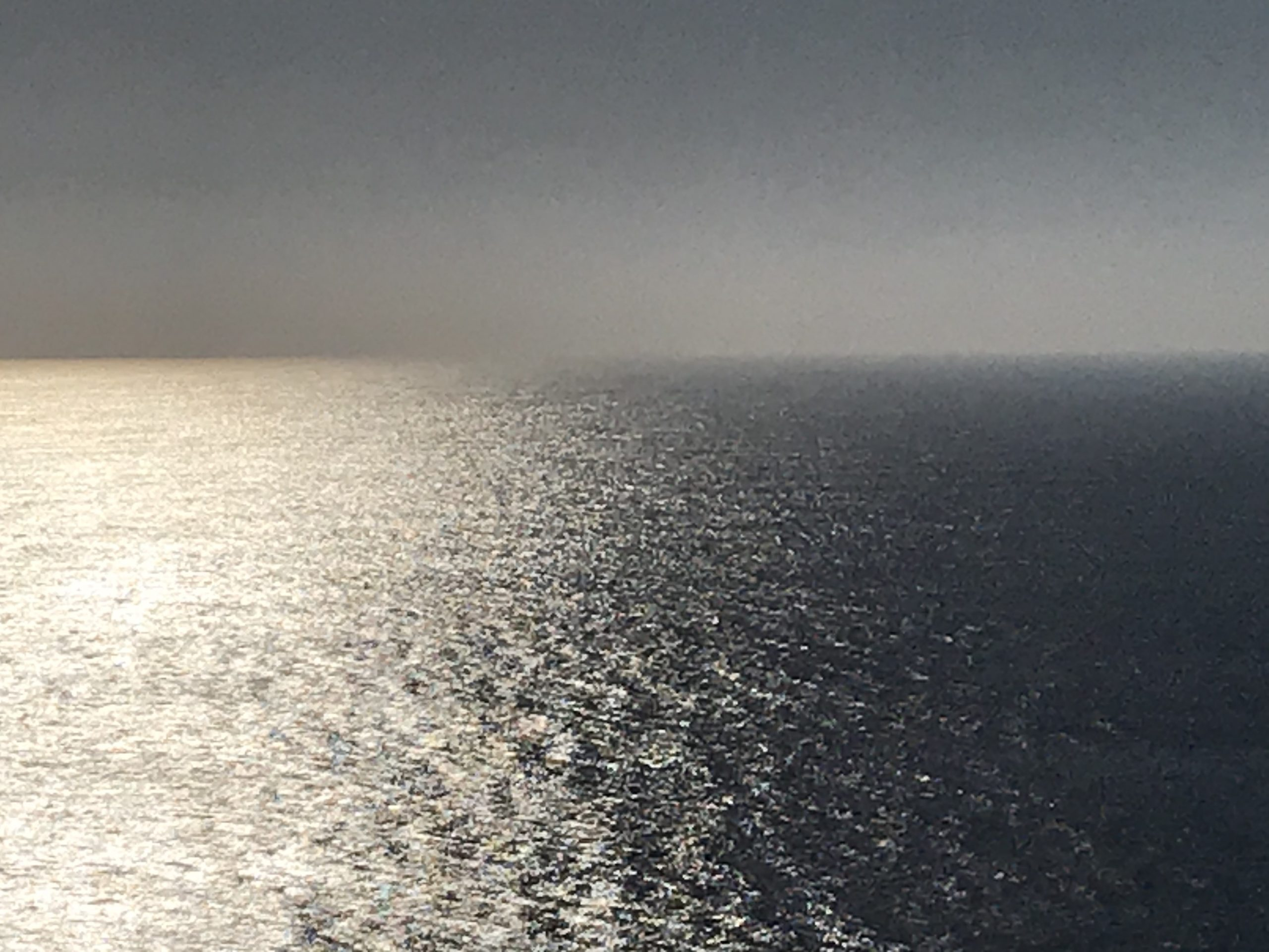 A shimmering view of the sea from a clifftop