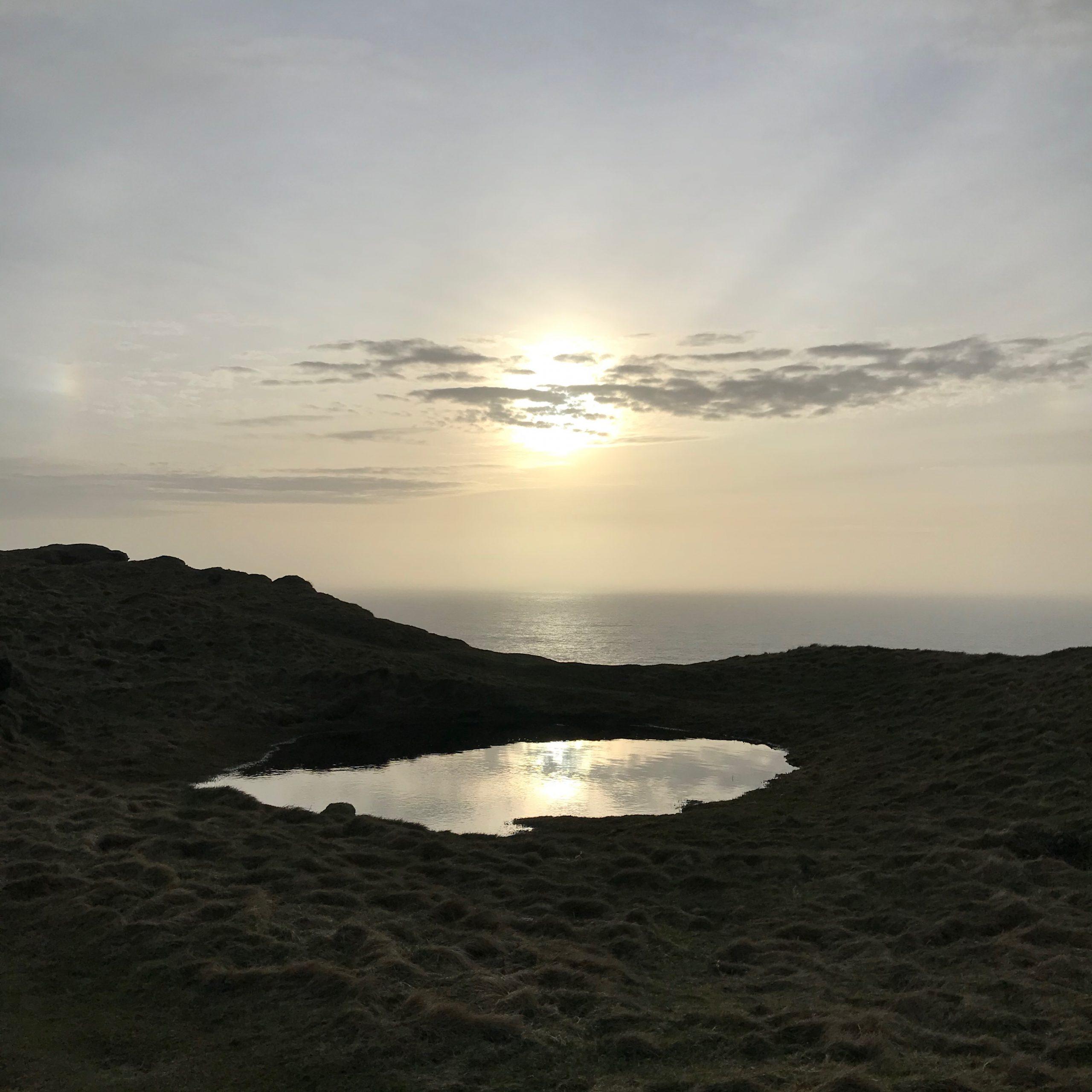Sun in a pool of water